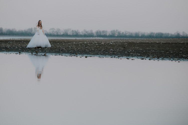 bride walking through the lake